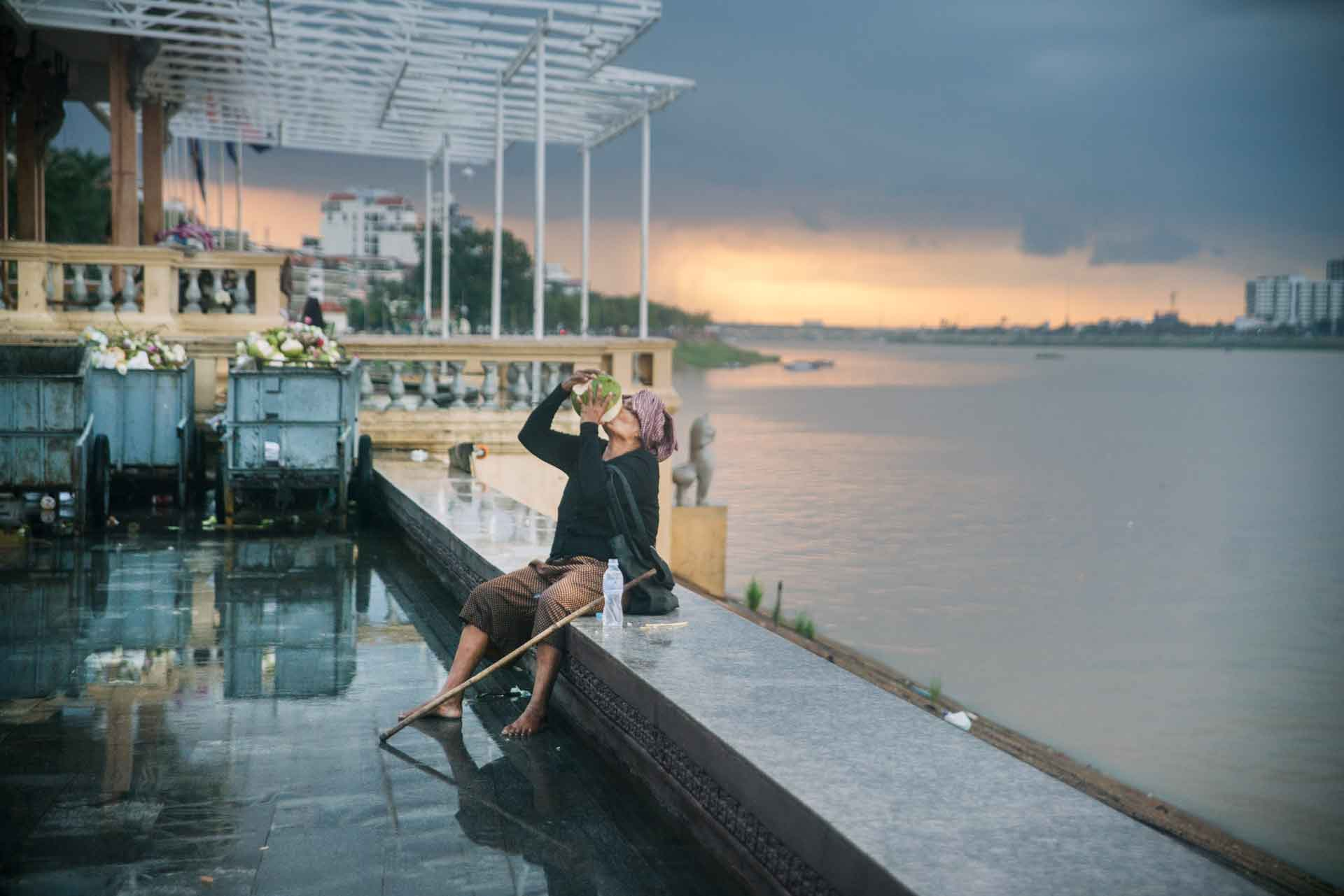 lady drinking in cambodia